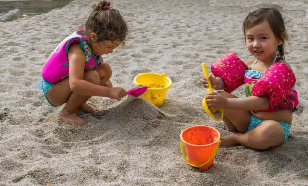 girls playing in sand