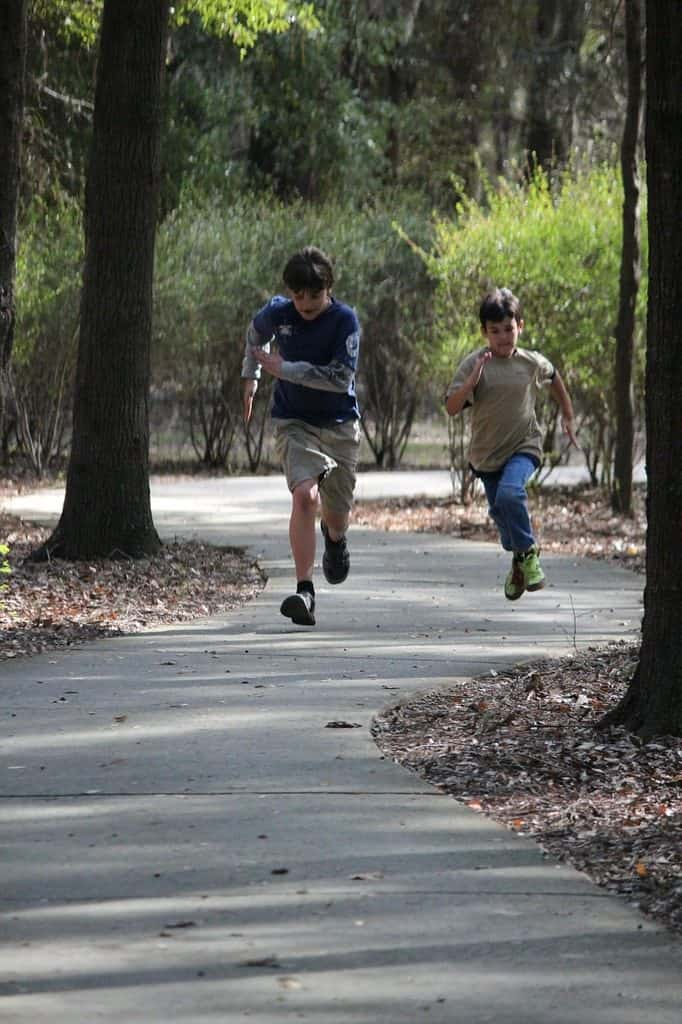 boys running on a trail