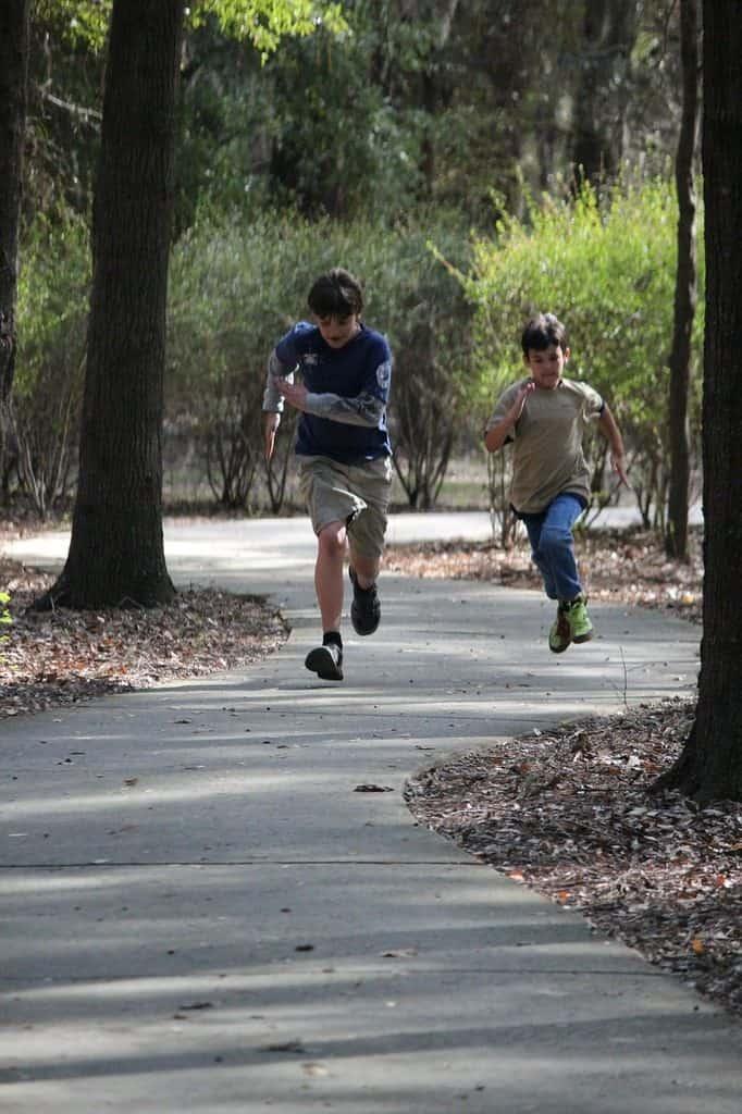 boys running on a trail