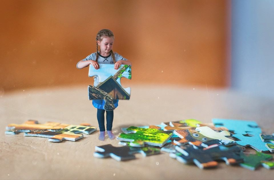child holding puzzle piece