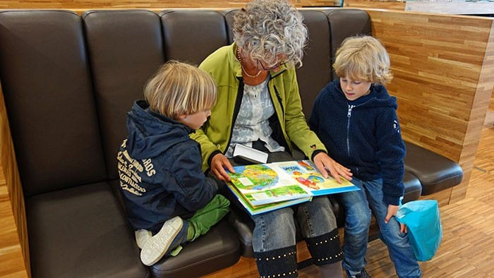 older woman reading to children