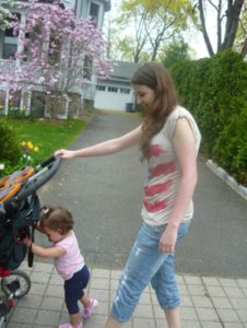 woman pushing stroller with child