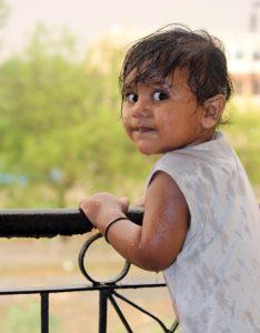 wet child on railing