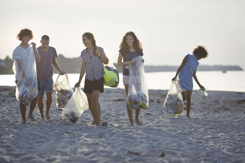Teenagers doing beach clean