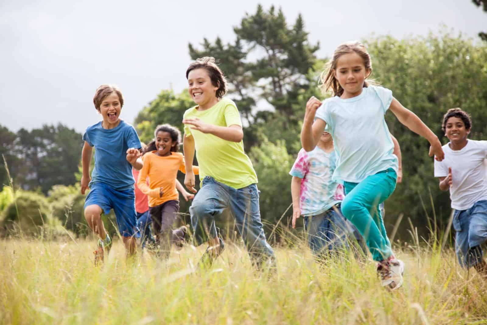Children running together in a park