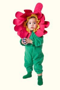 Baby girl (12-15 months) wearing flower costume, looking away