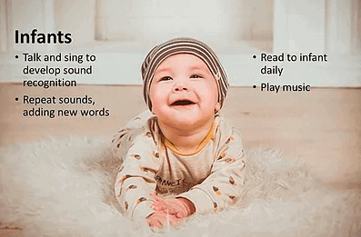 baby laughing on floor