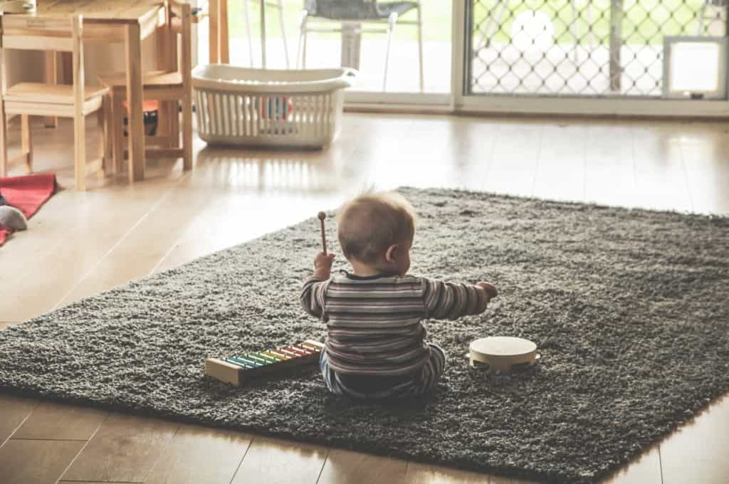 baby playing with instruments