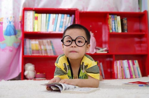 boy with glasses reading