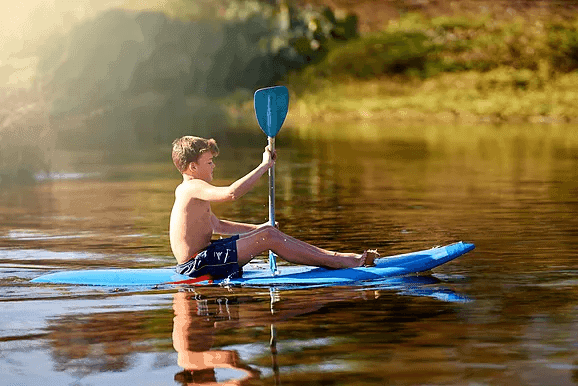 boy on paddle board