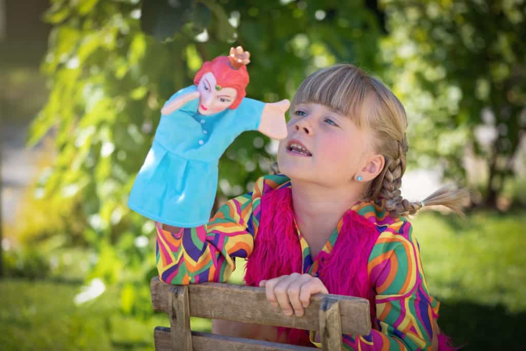child playing with puppet doll
