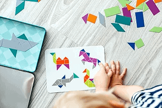 child making paper collage