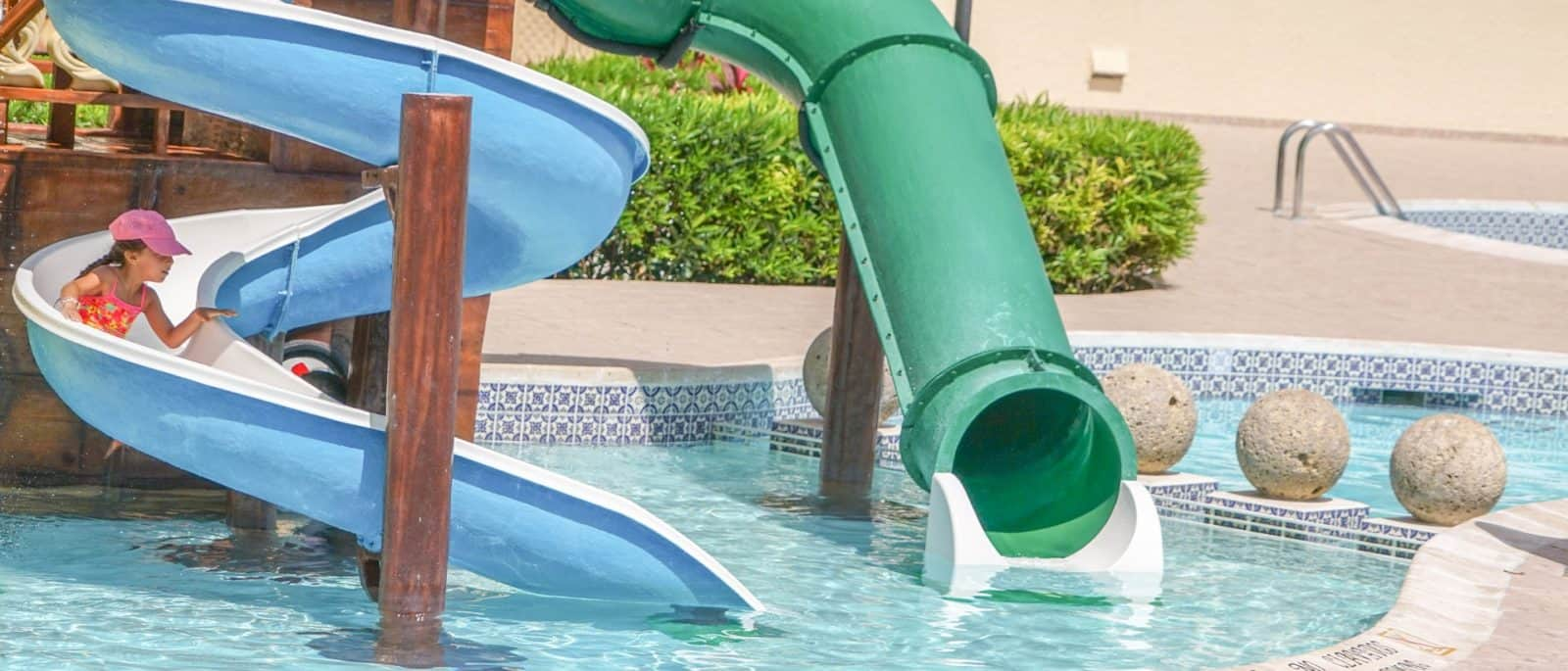 girl on slide in pool