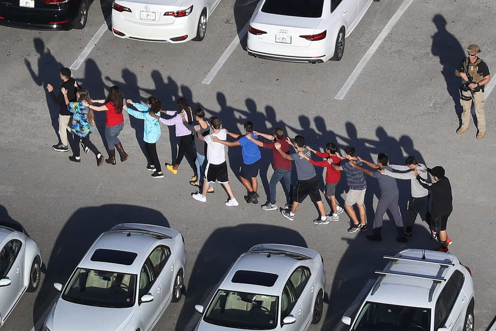 kids lining up in parking lot after shooting
