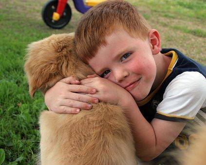 boy hugs dog