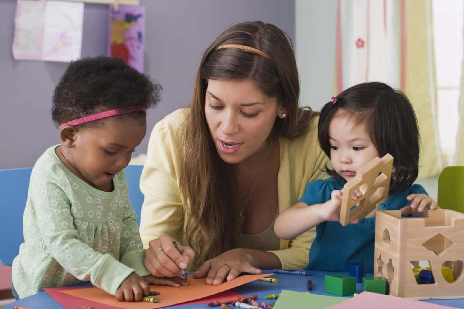 woman coloring with children
