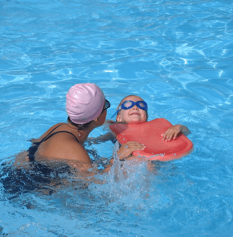 woman swimming with child