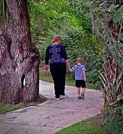 woman walking with child on trail